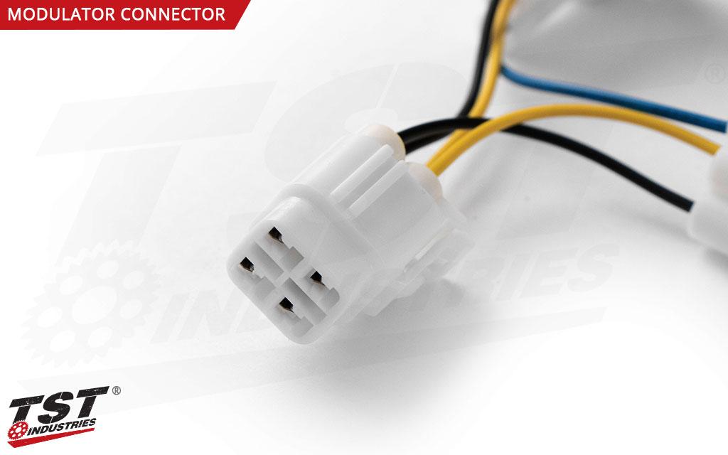 Close up of the harness converter TST Brake Light Modulator connection plug.