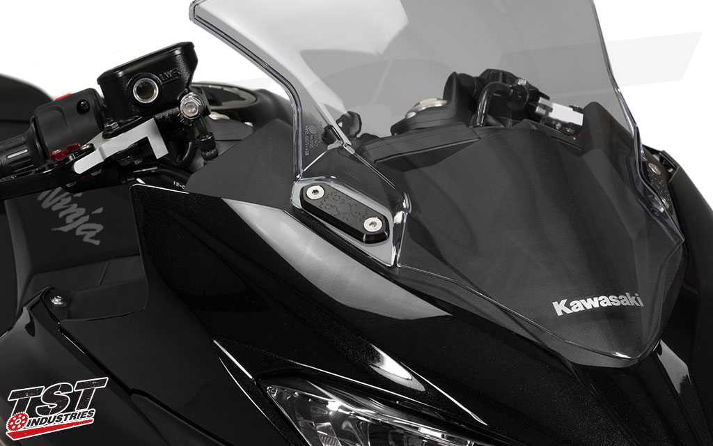 Ditch your mirrors and secure your Ninja 400's upper fairing with the TST Mirror Block Off Plates.
