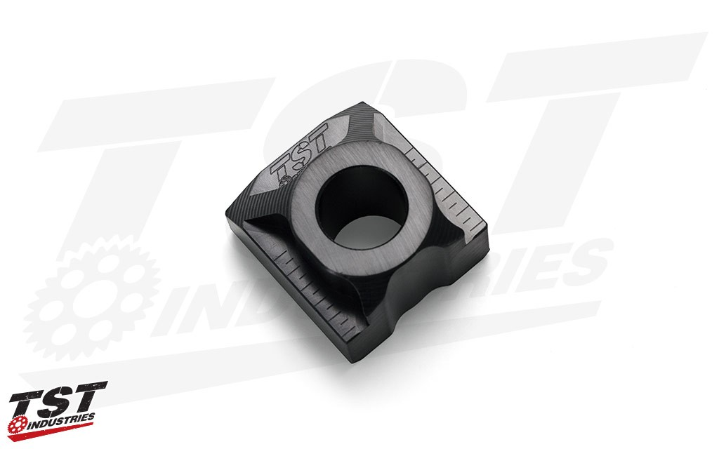 Simply and easily ditch the stock fender with our anodized black CNC machined Axle Block.