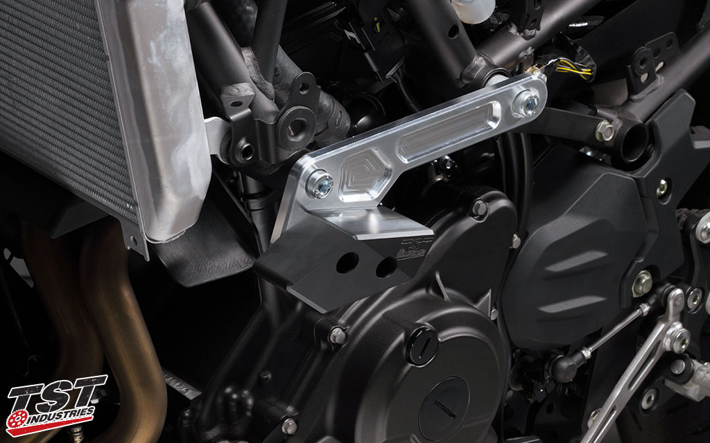 The TST dual mounting point bracket is placed behind the Ninja 400 side fairings.