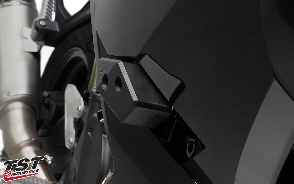 CNC delrin sliders have been specifically designed to fit within the Ninja 400 side fairings.