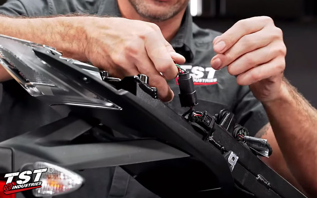 Bart showing the TST Male Plug Connector being installed on the BMW S1000RR.