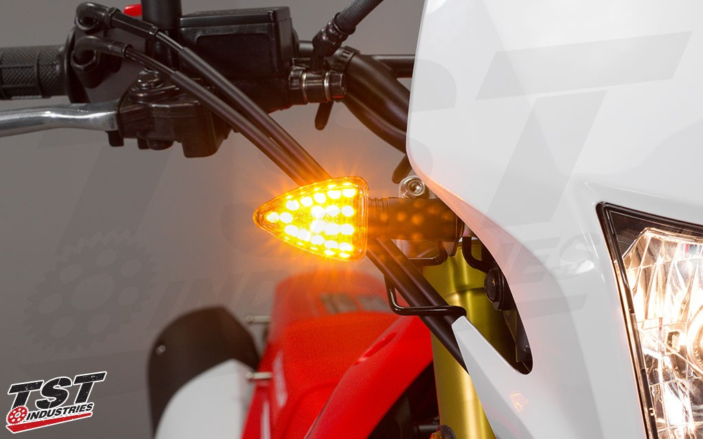Bright LED ARO18 pod turn signals demand attention when on the Honda CRF250L.
