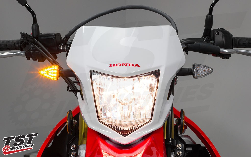 TST LED ARO18 pod turn signals on the Honda CRF250L.