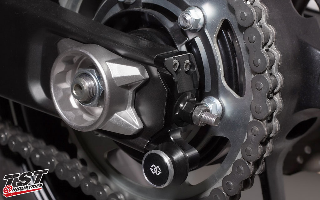 Installs on the rear of your swingarm and stays in place during rear wheel assembly removal.