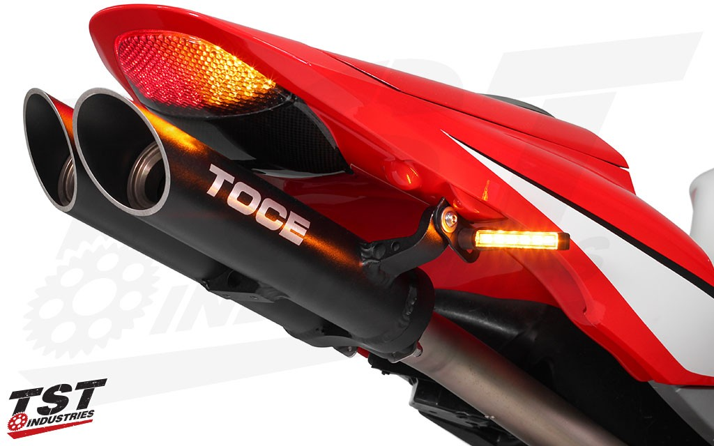 Works with most aftermarket rear turn signals. (TST Industries BL6 LED Rear Pod Turn Signals shown)