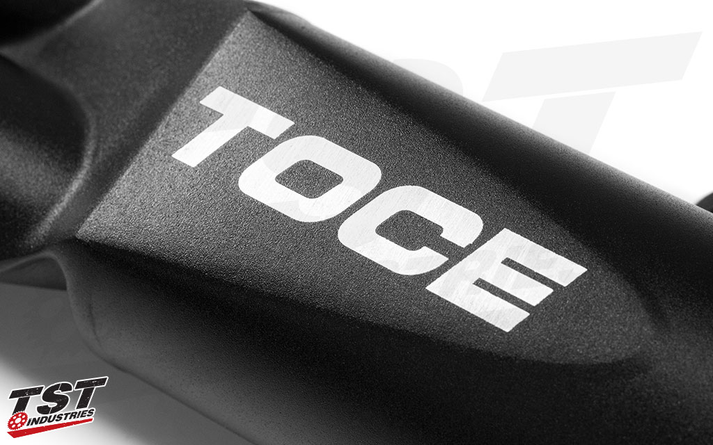 Features Toce logo on the dual outlet canister.
