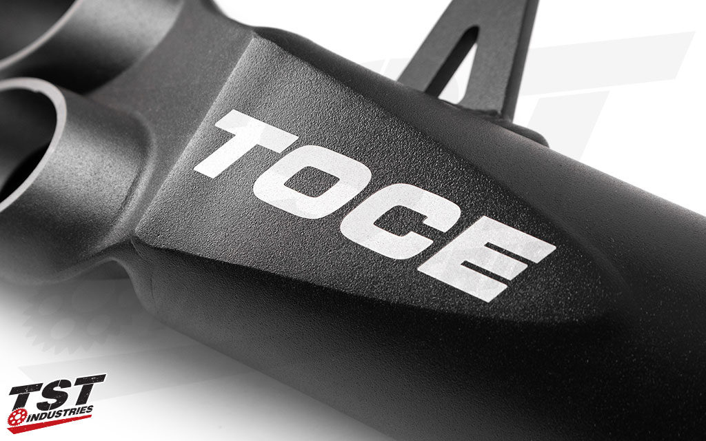 Features the Toce logo on the Razor Tip Slip-On canister.