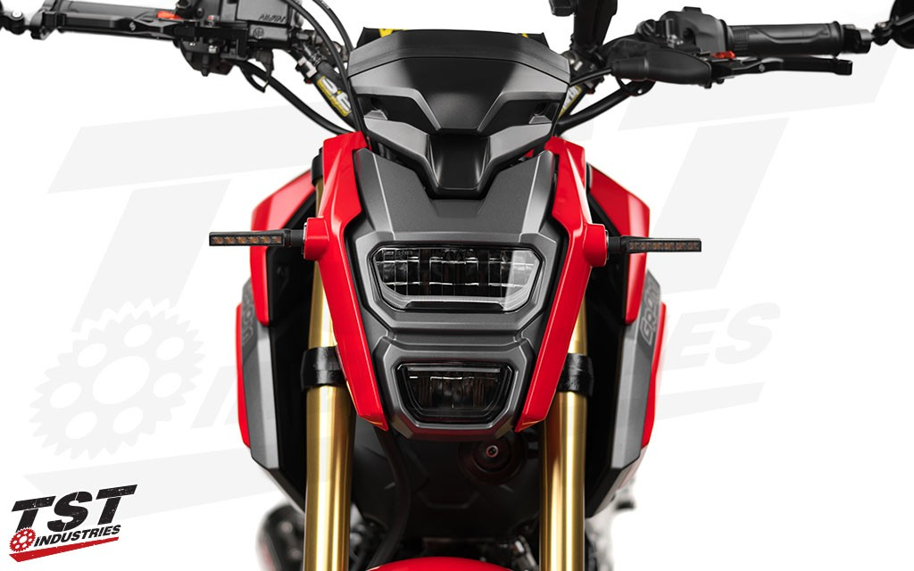 Upgrade your Honda Grom with TST LED BL6 Pod Turn Signals. (Smoke version shown)