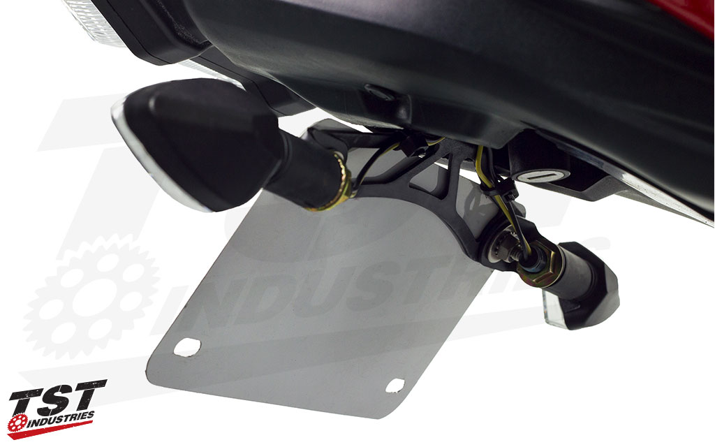 Included mounting hardware creates a clean mounting location for most license plate setups.