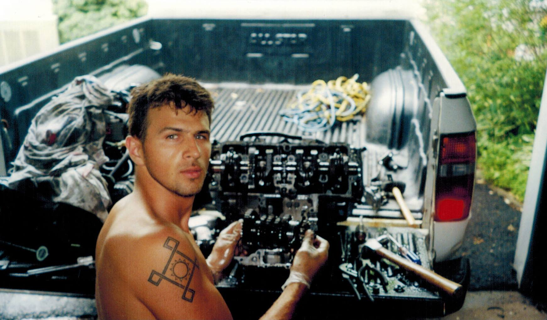 Founder of TST Industries, Bart Rogowski, working on a motorcycle engine when he was young.