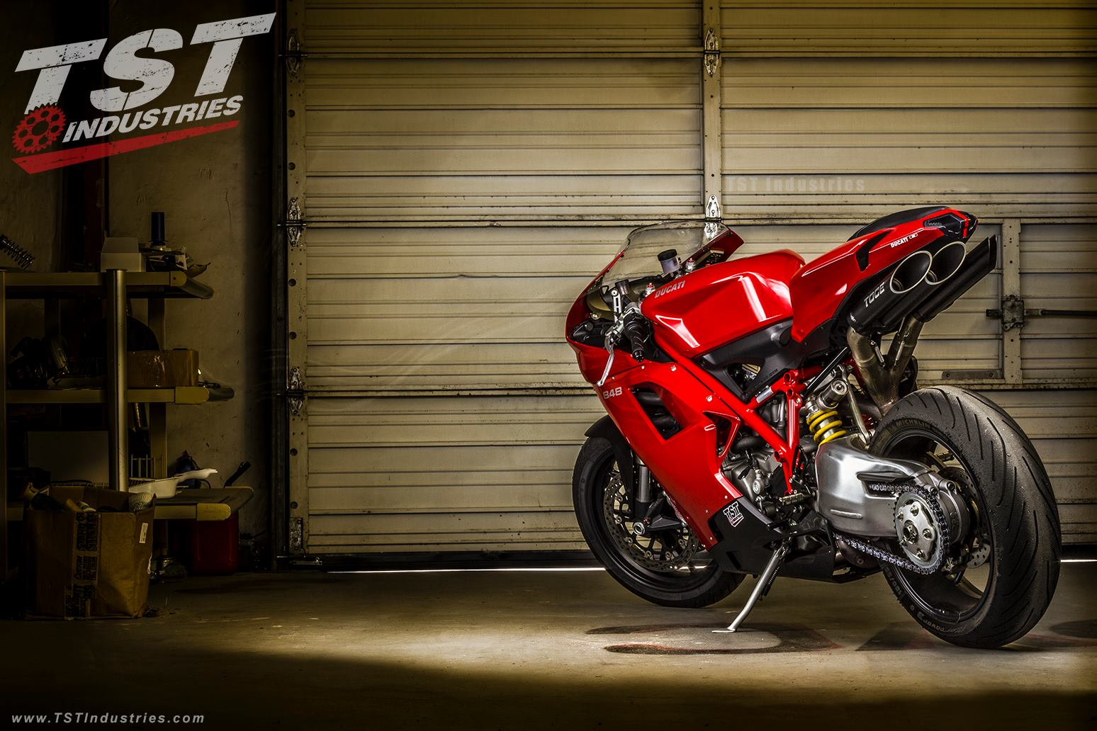 Photoshoot of a red Ducati 848 in the TST Garage with aftermarket parts installed.