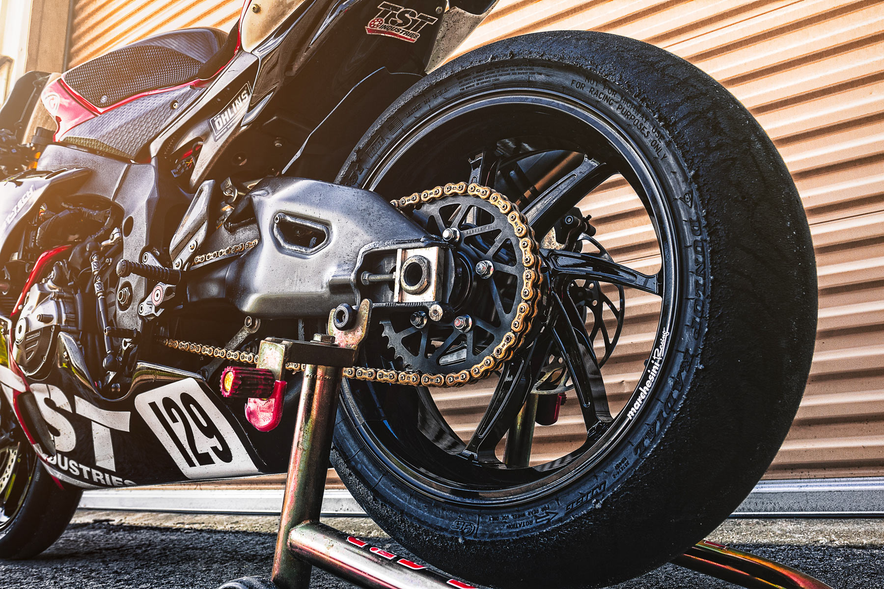 The TST Race YZF-R1 showing off it's high performance wheels and swingarm assembly.