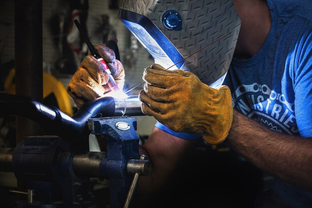 Bart welding on a subframe for a motorcycle.